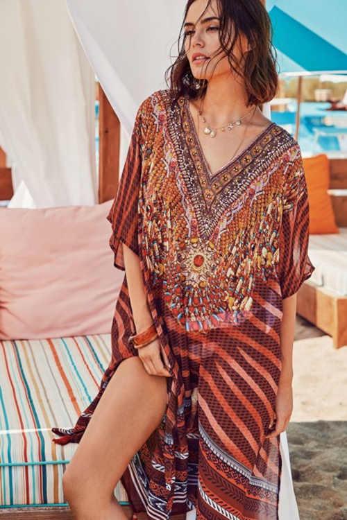 Plážové šaty v pohodlnom strihu a s geometrickým vzorom